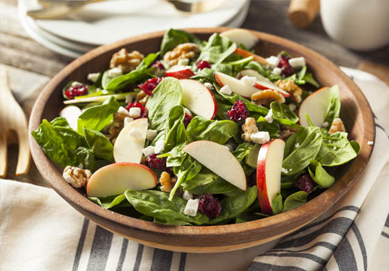 Spinach salad with apples, walnuts, cranberries, & goat cheese